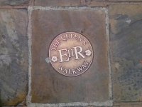 Seal indicating the Queen's Walkway