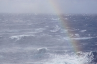 Stormy_waters_rainbow.JPG